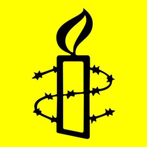 Amnesty-Kerze als Symbol der Hoffnung